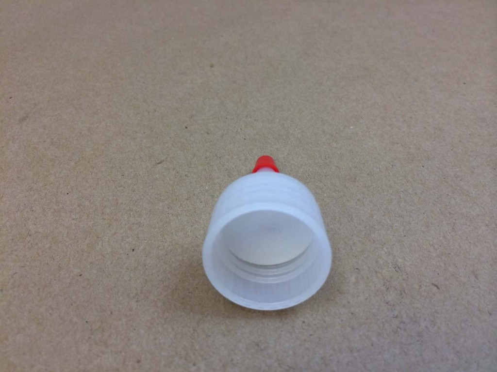 24 410   24 410 Natural/Red Tip  Round  Plastic   Spout Cap