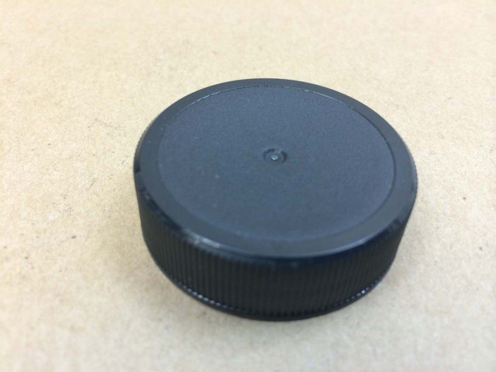 38 400 Black  Ribbed Sides/Stipple Top  Plastic   Cap