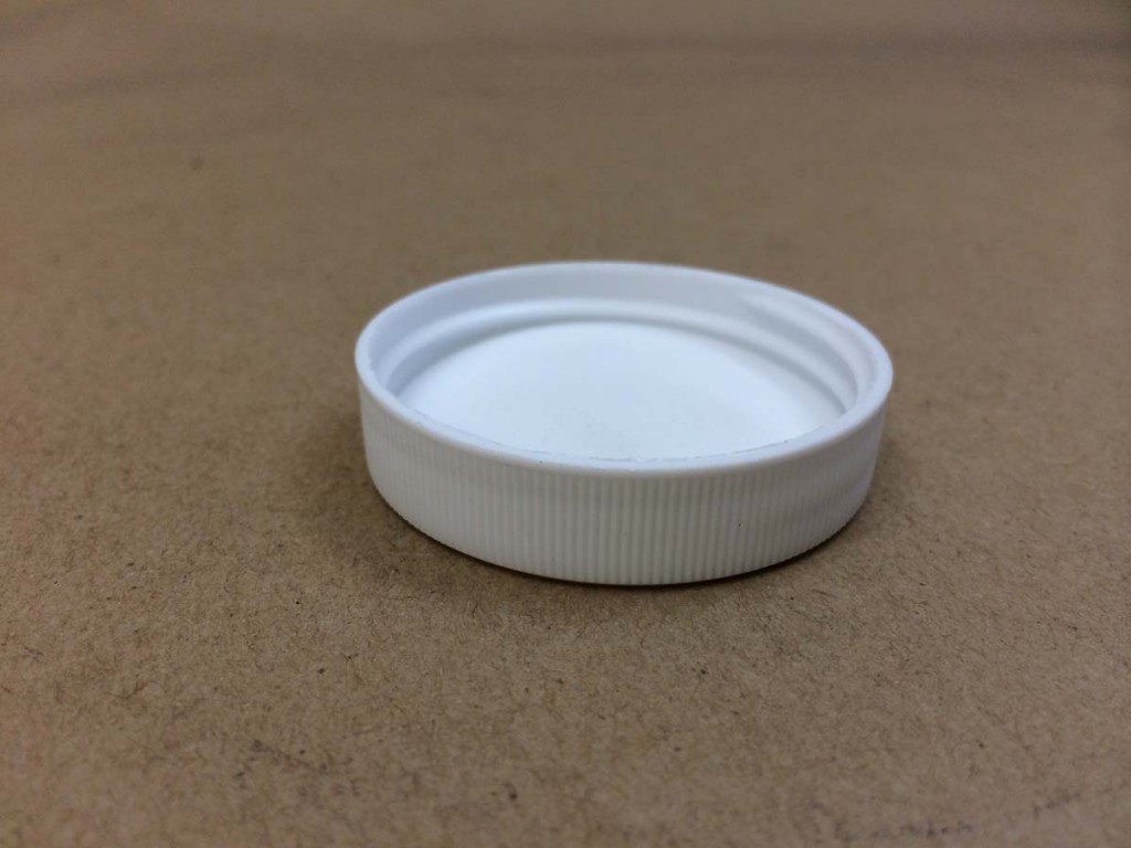 48 400 White  Ribbed Sides/Stipple Top  Plastic   Cap