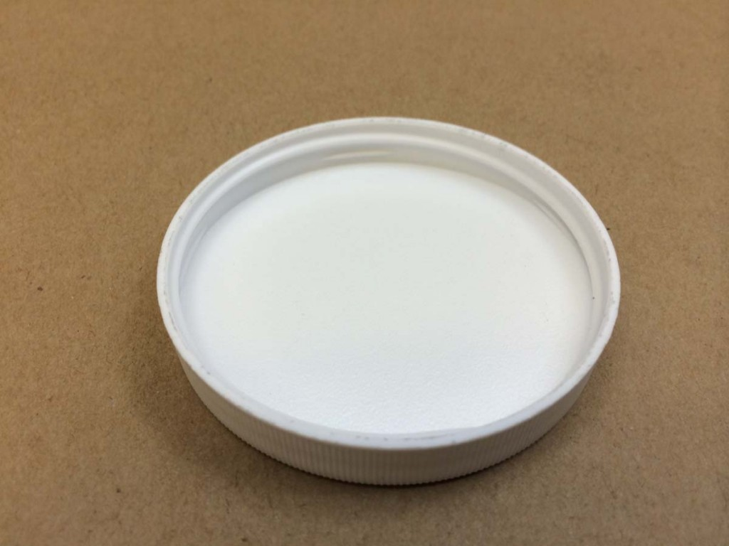 70 400 White  Ribbed Sides/Stipple Top  Plastic   Cap