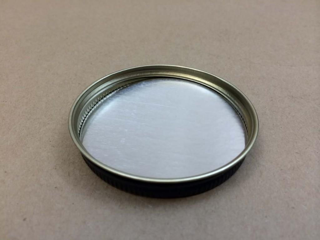 63 400   63 400 Black  Round  Metal   Cap