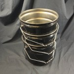 nested 3.5 gallon steel pails