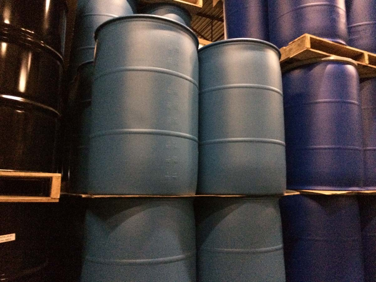 55 Gallon Blue Plastic Drums In Stack
