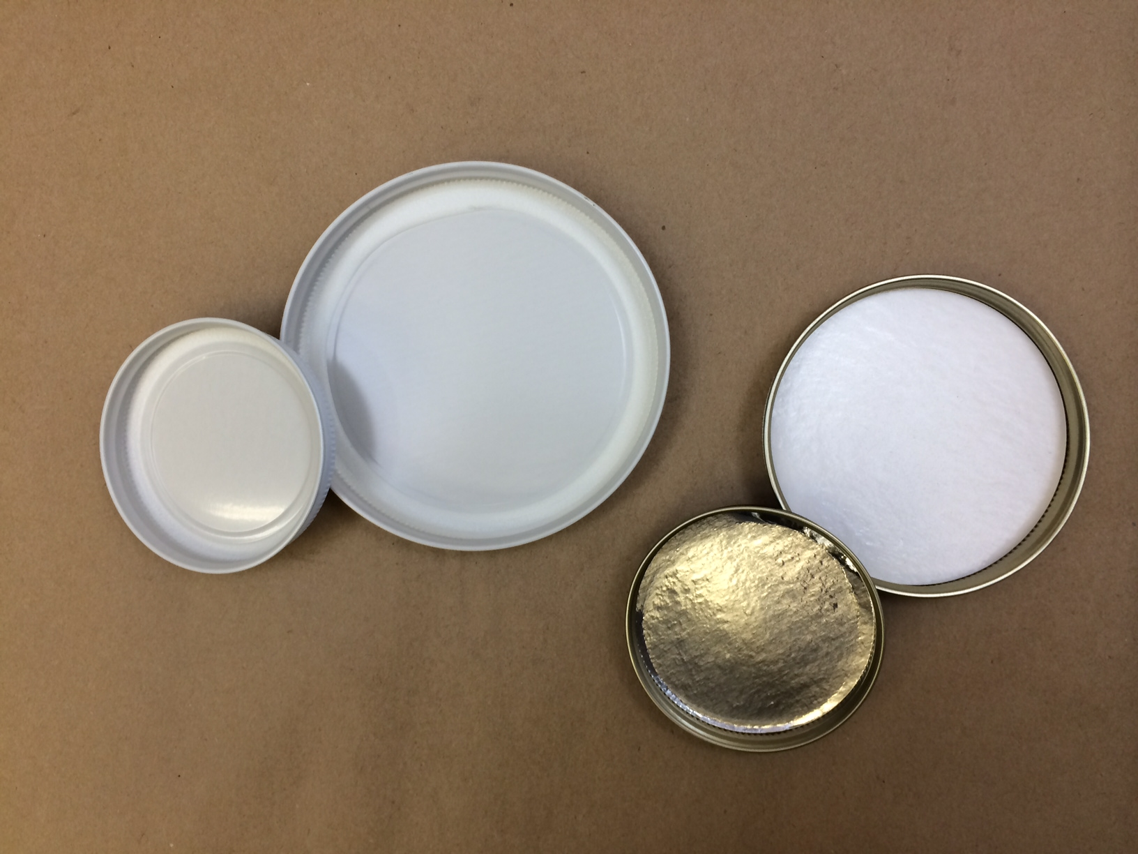 Plastisol Metal Caps. Foil and poly lined metal.