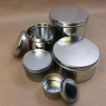 cookie tins, metal cans, holiday tins, ink can, slip cover cans.